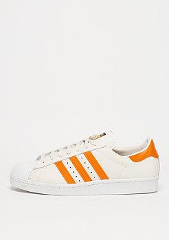 Schuh Superstar 80s off white/equipment orange/core black
